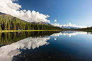 Clouds reflected in lake in Wrangell-St. Elias National Park in Southcentral Alaska. Summer. Morning.