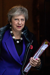 © Licensed to London News Pictures. 31/10/2018. London, UK. British Prime Minister Theresa May leaves 10 Downing Street to attend Prime Ministers Questions in Parliament. On Monday this week Chancellor of the Exchequer Philip Hammond announced the Autumn budget. Photo credit : Tom Nicholson/LNP