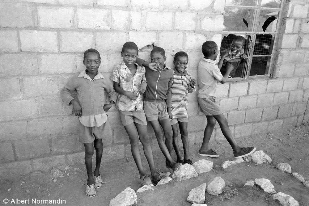 School boys laughing outside of classroom, 6, Cherhou School