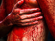 24 OCTOBER 2015 - YANGON, MYANMAR:     A Shia man's bloodied chest while he participates in ritual self flagellation with razors and chains during Ashura observances at Mogul Mosque in Yangon. Ashura commemorates the death of Hussein ibn Ali, the grandson of the Prophet Muhammed, in the 7th century. Hussein ibn Ali is considered by Shia Muslims to be the third imam and the rightful successor of Muhammed. He was killed at the Battle of Karbala in 610 CE on the 10th day of Muharram, the first month of the Islamic calendar. According to Myanmar government statistics, only about 4% of the population is Muslim. Many Muslims have fled Myanmar in recent years because of violence directed against Burmese Muslims by Buddhist nationalists.    PHOTO BY JACK KURTZ