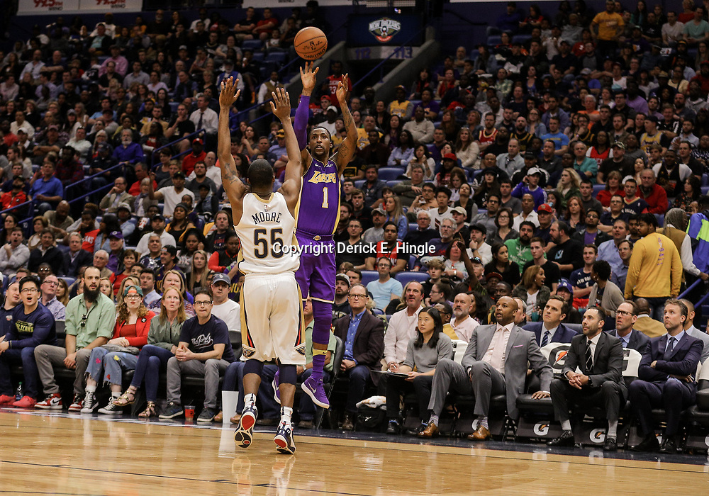 Mar 22, 2018; New Orleans, LA, USA; Los Angeles Lakers guard Kentavious Caldwell-Pope (1) shoots over New Orleans Pelicans forward E'Twaun Moore (55) during the second quarter at the Smoothie King Center. Mandatory Credit: Derick E. Hingle-USA TODAY Sports