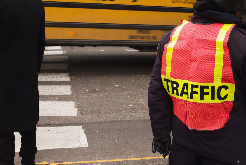 Traffic cop and school bus, Midtown, New York City, 2007.