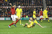 Leeds United defender Charlie Taylor blocks the shot from Nottingham Forest forward, on loan from Benfica, Nelson Oliveira  during the Sky Bet Championship match between Nottingham Forest and Leeds United at the City Ground, Nottingham, England on 27 December 2015. Photo by Simon Davies.