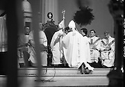 Episcopal Ordination Of Desmond Connell. (R74).1988..06.03.1988..03.06.1988..6th March 1988..Following the death of Archbishop Kevin McNamara in April '87, Pope John Paul II surprisingly nominated Desmond Connell for the position of Archbishop of Dublin. The ordination of Dr Connell took place at the Pro-Cathedral in Dublin...Image shows Dr Connell donning the Mitre of Office and accepting the crozier as he is conferred as Archbishop of Dublin.