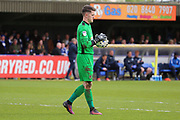 AFC Wimbledon goalkeeper Joe McDonnell (24) holding the ball during the EFL Sky Bet League 1 match between AFC Wimbledon and Peterborough United at the Cherry Red Records Stadium, Kingston, England on 17 April 2017. Photo by Matthew Redman.