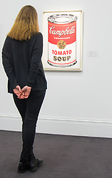 Sotheby's, London, January 28th 2016. A woman admires Andy Warhol's Large Campbell's Soup Can from 1964, which is expected to fetch up to £6.5 million, to be auctioned by Sotheby's in London as part of their sale of Impressionist, Modern, Surrealist and Contemporary art. ///FOR LICENCING CONTACT: paul@pauldaveycreative.co.uk TEL:+44 (0) 7966 016 296 or +44 (0) 20 8969 6875. ©2015 Paul R Davey. All rights reserved.