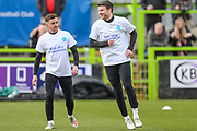 Forest Green Rovers Chris Stokes(30) and Forest Green Rovers Elliott Frear(17) warming up during the EFL Sky Bet League 2 match between Forest Green Rovers and Walsall at the New Lawn, Forest Green, United Kingdom on 8 February 2020.