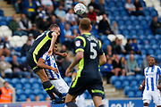 Carlisle United's Clint Hill heads the ball during the EFL Sky Bet League 2 match between Colchester United and Carlisle United at the Weston Homes Community Stadium, Colchester, England on 14 October 2017. Photo by Phil Chaplin