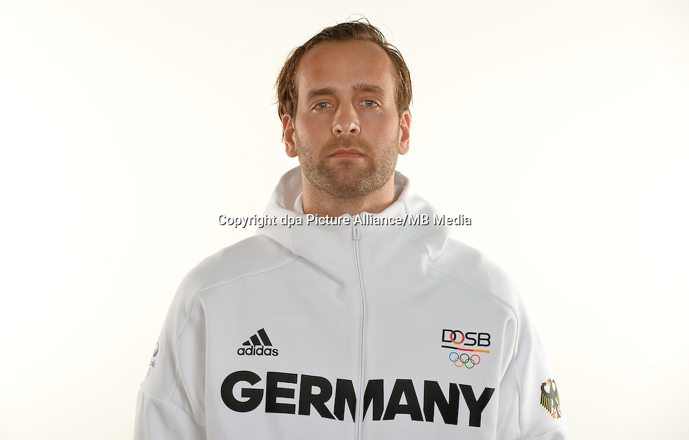 Silvio Heinevetter poses at a photocall during the preparations for the Olympic Games in Rio at the Emmich Cambrai Barracks in Hanover, Germany. July 27, 2016. Photo credit: Frank May/ picture alliance.   usage worldwide