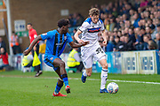 Gillingham FC midfielder Callum Reilly (13) and Rochdale  defender Joe Bunney (39) during the EFL Sky Bet League 1 match between Gillingham and Rochdale at the MEMS Priestfield Stadium, Gillingham, England on 30 March 2019.