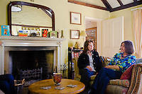 Mosquito Cottage on Main Street, sisters  Gillian and Rosemary Vincent chat in the front room,  Bishop Wilton village East Yorkshire.