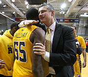 LaSalle's head coach Dr. John Giannini hugs Ramon Galloway who scored the game winning basket against Butler beat them 54-53 at Tom Gola Arena in Philadelphia.