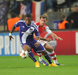Arsenal's Nacho Monreal comes up against Anderlecht's Gohi Bi Cyriac - Photo mandatory by-line: Dougie Allward/JMP - Mobile: 07966 386802 - 22/10/2014 - SPORT - Football - Anderlecht - Constant Vanden Stockstadion - R.S.C. Anderlecht v Arsenal - UEFA Champions League - Group D