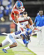 Mississippi wide receiver Cody Core (88) is upended by Memphis defensive back Andrew Gaines (28) at Vaught-Hemingway Stadium in Oxford, Miss. on Saturday, September 27, 2014. (AP Photo/Oxford Eagle, Bruce Newman)
