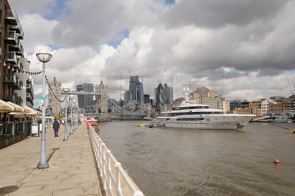 © Licensed to London News Pictures. 29/03/2018. London, UK. The 220ft custom luxury superyacht, 'Global' moored at Butlers Wharf near Tower Bridge during a London visit. Previously named, Kismet during her last central London visit, she underwent a refit which saw her moved up 51 places in Boat International's list of top 200 largest super yachts in the world, boasting numerous luxuries such as a helipad, cinema and jacuzzi. Believed to be owned by Fulham Football Club chairman, Shahid Khan, Global can be chartered for an estimated £1m per week. Powered by 2 Caterpillar (3512 B) 2,038hp diesel engines and propelled by her twin screws propellers, Global is capable of a top speed of 15.5 knots, and comfortably cruises at 14 knots.. Photo credit: Vickie Flores/LNP