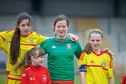 NEWPORT, WALES - Friday, April 1, 2016: Wales' Thierry-Jo Gauvain, goalkeeper Deanna Lewis and captain Hayley Hoare line up for the national anthem before the game against England during Day 1 of the Bob Docherty International Tournament 2016 at Dragon Park. (Pic by David Rawcliffe/Propaganda)