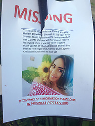 A poster with a picture of Mariem Elgwahry on, one of those reported missing, close to the scene after a fire engulfed the 24-storey Grenfell Tower in west London yesterday.