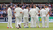 New Zealand Tim Southee and the New Zealand players gather after the wicket of England debutant Adam Lyth during the first day of the Investec 1st Test  match between England and New Zealand at Lord's Cricket Ground, St John's Wood, United Kingdom on 21 May 2015. Photo by Ellie  Hoad.