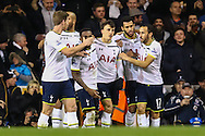 Vlad Chiriches of Tottenham Hotspur (3rd right) celebrates scoring his team's third goal against Burnley to make it 3-2 during the FA Cup match at White Hart Lane, London<br /> Picture by David Horn/Focus Images Ltd +44 7545 970036<br /> 14/01/2015