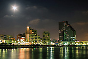 Israel Tel Aviv The shoreline at night as seen from the Mediterranean sea. The Opera Tower on the right