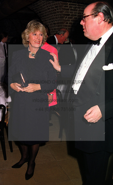 MRS CAMILLA PARKER BOWLES and the HON.NICHOLAS SOAMES, at a gala evening in London on 6th October 1999.MXH 13