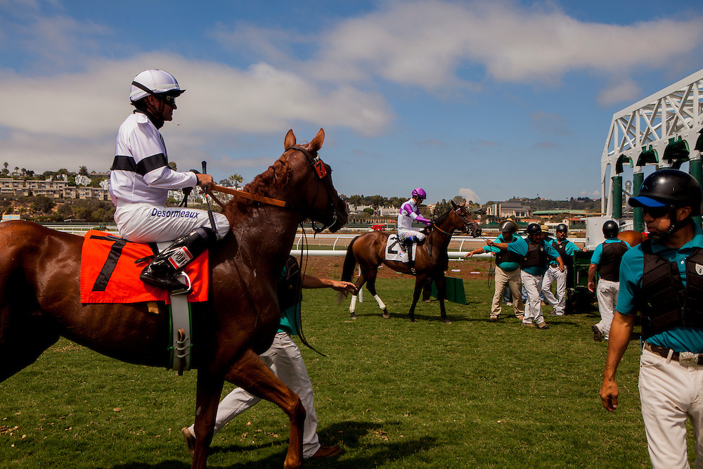 DEL MAR, CA - AUGUST 13, 2014: Horses and riders prepare to race on the turf track at the Del Mar Thoroughbred Club. CREDIT: Sam Hodgson for The New York Times