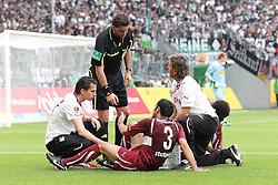 13.08.2011,  BorussiaPark, Mönchengladbach, GER, 1.FBL, Borussia Mönchengladbach vs Vfb Stuttgart, im Bild.Cristian Molinaro (Stuttgart #3) verletzt am Boden..// during the 1.FBL, Borussia Mönchengladbach vs VFB Stuttgart on 2011/08/13, BorussiaPark, Mönchengladbach, Germany. EXPA Pictures © 2011, PhotoCredit: EXPA/ nph/  Mueller *** Local Caption ***       ****** out of GER / CRO  / BEL ******