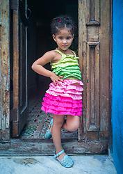 Cuban girl posing at doorway. Havana.