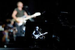 A video camera system captures bassist and lead vocalist Sting of The Police performed in concert at the John Paul Jones Arena in Charlottesville, VA on November 6, 2007.