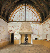 Antechamber used for guests, decorated in 2012 with mural paintings inspired by the 13th century decoration at the nearby Eglise de Saint Pierre in Moutiers-en-Puisaye, in the North Range or Logis Seigneurial, at the Chateau de Guedelon, a castle built since 1997 using only medieval materials and processes, photographed in 2017, in Treigny, Yonne, Burgundy, France. The walls of the room were prepared with lime plaster and lime wash and the floral motifs painted on top. The Guedelon project was begun in 1997 by Michel Guyot, owner of the nearby Chateau de Saint-Fargeau, with architect Jacques Moulin. It is an educational and scientific project with the aim of understanding medieval building techniques and the chateau should be completed in the 2020s. Picture by Manuel Cohen