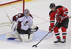 Oct 15; Newark, NJ, USA; New Jersey Devils right wing Jamie Langenbrunner (15) tips a puck in front of Colorado Avalanche goalie Craig Anderson (41) during the third period at the Prudential Center. The Avalanche defeated the Devils 3-2.