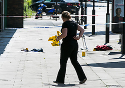 © Licensed to London News Pictures. 01/09/2018. London, UK. Evidence markers being placed  at the Scene on Caledonian Road in London where a woman in her 20's has been stabbed in broad daylight. Police were called to the scene shortly before 10.30am today. Photo credit: Dinendra Haria/LNP