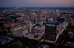 Texas Medical Center night time aerial view with Memorial Hermann Hospital in the foreground.