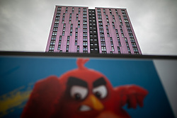© Licensed to London News Pictures . 11/10/2018. Salford , UK . GV of Thorn Court with temporary cladding fitted on the bottom three floors and unsafe cladding remaining in place above . Recently installed cladding at several council-owned tower blocks in Salford has been identified as having similar dangerous properties to that which was installed on the Grenfell Tower in London . Residents have been waiting months for clarification on what action will be taken to make their homes safe . Photo credit : Joel Goodman/LNP