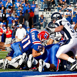 December 4, 2010; Ruston, LA, USA;  Louisiana Tech Bulldogs quarterback Ross Jenkins (11) scores against the Nevada Wolf Pack during the first half at Joe Aillet Stadium.  Mandatory Credit: Derick E. Hingle