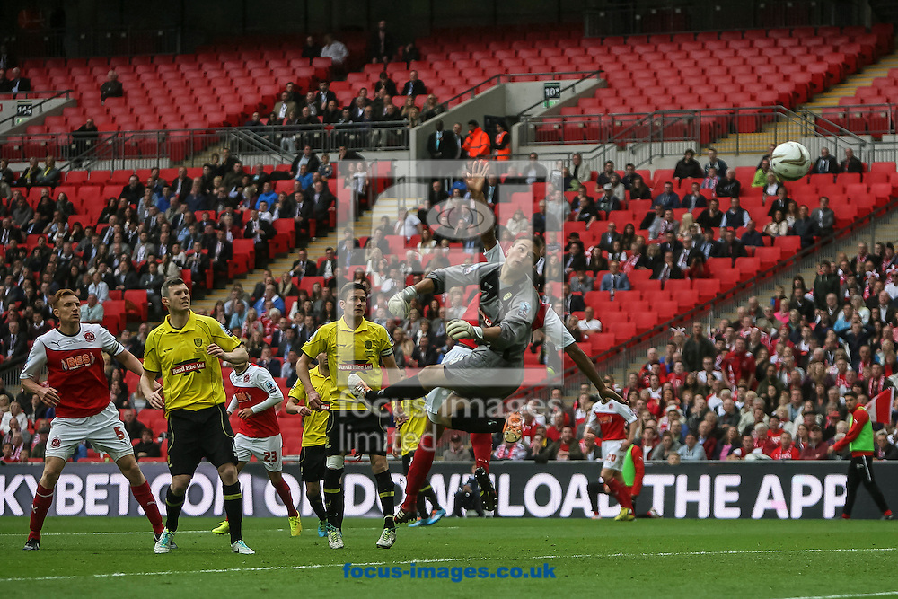 The ball flies over Dean Lyness of Burton Albion's head as Antoni Sarcevic of Fleetwood Town scores his side&rsquo;s first goal to make the score 0-1 during the Sky Bet League 2 match at Wembley Stadium, London<br /> Picture by Daniel Chesterton/Focus Images Ltd +44 7966 018899<br /> 26/05/2014