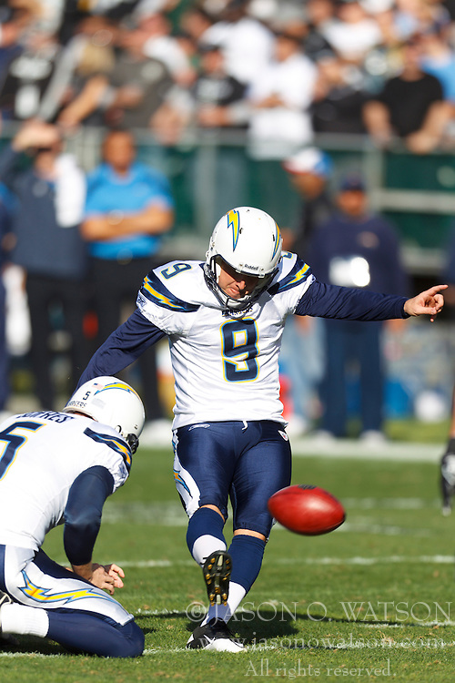 Jan 1, 2012; Oakland, CA, USA; San Diego Chargers kicker Nick Novak (9) kicks an extra point off the hold from punter Mike Scifres (5) during the first quarter against the Oakland Raiders at O.co Coliseum. San Diego defeated Oakland 38-26. Mandatory Credit: Jason O. Watson-US PRESSWIRE