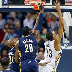 Oct 30, 2013; New Orleans, LA, USA; New Orleans Pelicans power forward Anthony Davis (23) shoots over Indiana Pacers center Ian Mahinmi (28) during the first half of a game at New Orleans Arena. Mandatory Credit: Derick E. Hingle-USA TODAY Sports
