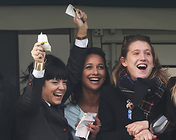 Lily Allen (left) celebrates with friends as the winner of the Cheltenham Gold Cup crosses the line  at the Cheltenham Festival, United Kingdom, Friday, 14th March 2014. Picture by Stephen Lock / i-Images