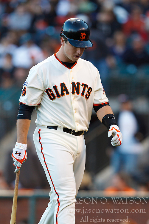 May 25, 2011; San Francisco, CA, USA;  San Francisco Giants catcher Buster Posey (28) returns to the dugout after striking out against the Florida Marlins during the first inning at AT&T Park.