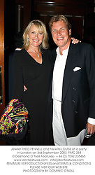Jewller THEO FENNELL and his wife LOUISE at a party in London on 3rd September 2003.PMC 254