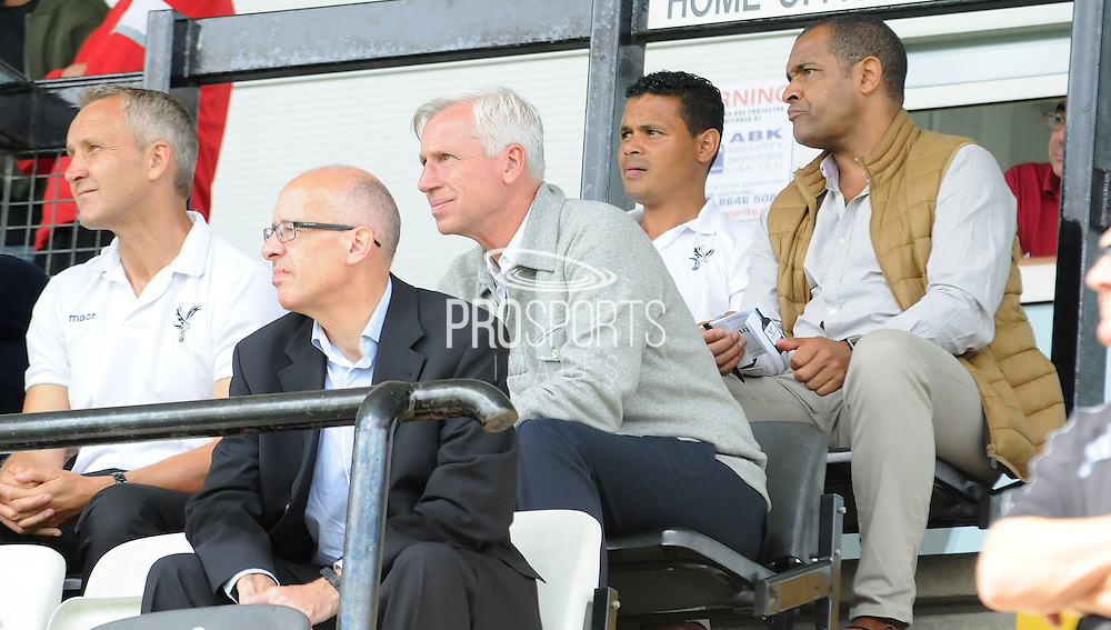 Alan Pardew, Mark bright, John Salako and Keith Millen watch the action unfold during the U21 Professional Development League match between U21 Crystal Palace and U21 Bolton Wanderers at Selhurst Park, London, England on 17 August 2015. Photo by Michael Hulf.