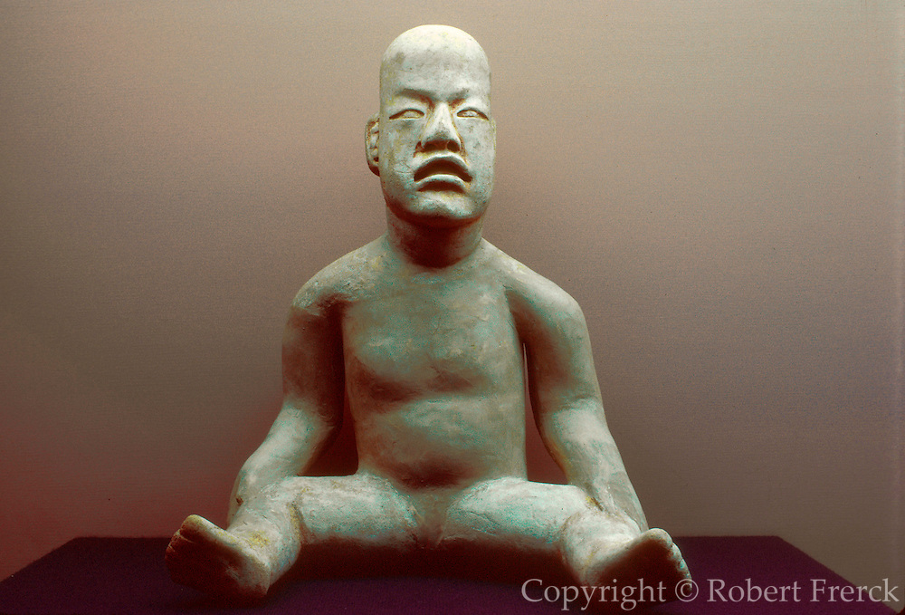 MEXICO, MEXICO CITY, MUSEUM Olmec 'baby' with feline features