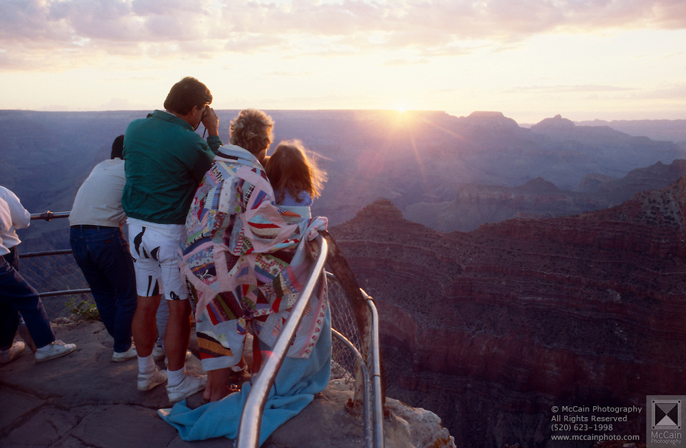 People watching sunrise from Mather Point, Grand Canyon National Park, Arizona...Subject photograph(s) are copyright Edward McCain. All rights are reserved except those specifically granted by Edward McCain in writing prior to publication...McCain Photography.211 S 4th Avenue.Tucson, AZ 85701-2103.(520) 623-1998.mobile: (520) 990-0999.fax: (520) 623-1190.http://www.mccainphoto.com.edward@mccainphoto.com.