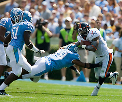 Virginia running back Cedric Peerman (37) evades North Carolina cornerback Jermaine Strong (38).  The North Carolina Tar Heels football team faced the Virginia Cavaliers at Kenan Memorial Stadium in Chapel Hill, NC on September 15, 2007.  UVA defeated UNC 22-20.