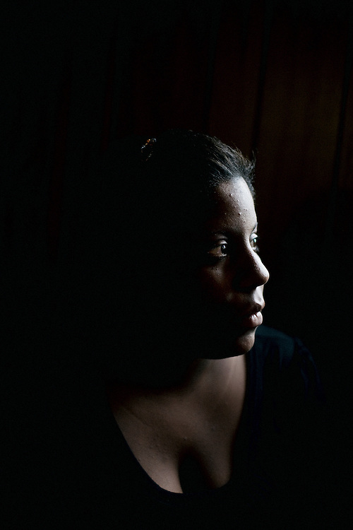 """Lettorea """"Lottie"""" Clark, 25, sits for a portrait in the apartment she shares with her daughter Gabby, 2, in Albany, GA on Friday, October 24, 2008. Lottie and Gabby live off welfare after escaping an abusive relationship with Gabby's father."""