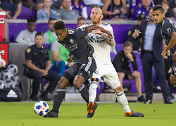 April 21, 2018 - Orlando, FL, U.S. - ORLANDO, FL - APRIL 21: Orlando City midfielder Cristian Higuita (7) protects ball possession during the MLS soccer match between the Orlando City FC and the San Jose Earthquakes at Orlando City SC on April 21, 2018 at Orlando City Stadium in Orlando, FL. (Photo by Andrew Bershaw/Icon Sportswire) (Credit Image: © Andrew Bershaw/Icon SMI via ZUMA Press)