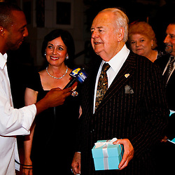June 16, 2010; New Orleans, LA, USA; New Orleans Saints owner Tom Benson and his wife Gayle talk to the media after receiving their championship rings at the Roosevelt Hotel where the New Orleans Saints received their Super Bowl rings for their victory of the Indianapolis Colts in Super Bowl XLIV.  Mandatory Credit: Derick E. Hingle