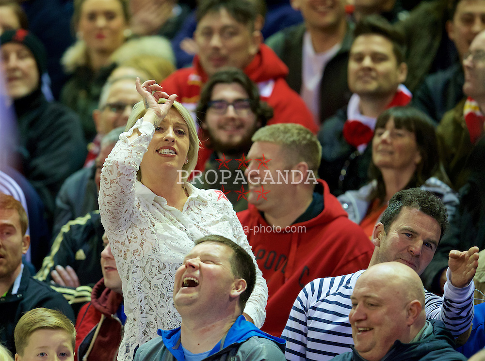 LIVERPOOL, ENGLAND - Wednesday, April 20, 2016: A Liverpool supporter in the Paddock taunts the visiting Everton fans during the Premier League match at Anfield, the 226th Merseyside Derby. (Pic by David Rawcliffe/Propaganda)