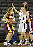 February 18, 2010: Minnesota forward Brianna Mastey (41) looks for someone to pass the ball to as Iowa guard Kamille Wahlin (2) defends during the first half of the NCAA women's basketball game at Carver-Hawkeye Arena in Iowa City, Iowa on February 18, 2010. Iowa defeated Minnesota 75-54.